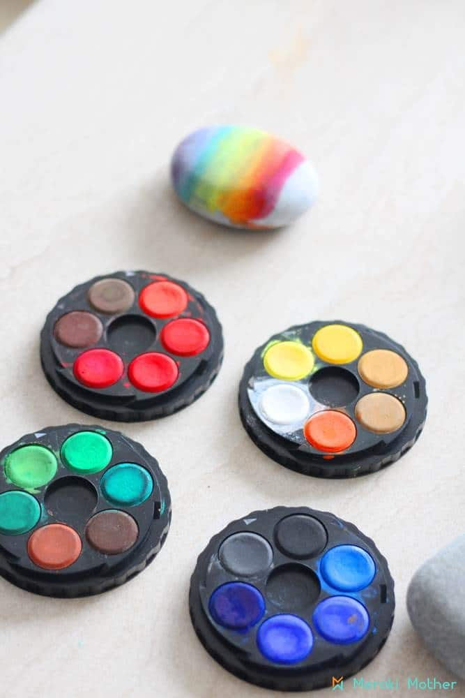 Rainbow watercolor rock painting activity for kids