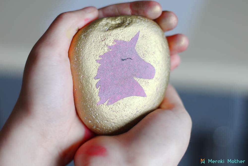painting unicorn on a stone