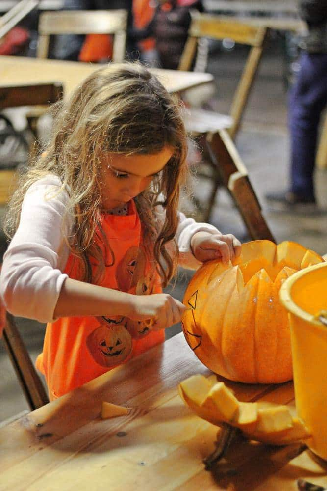 Cutting the eyes on the pumpkin