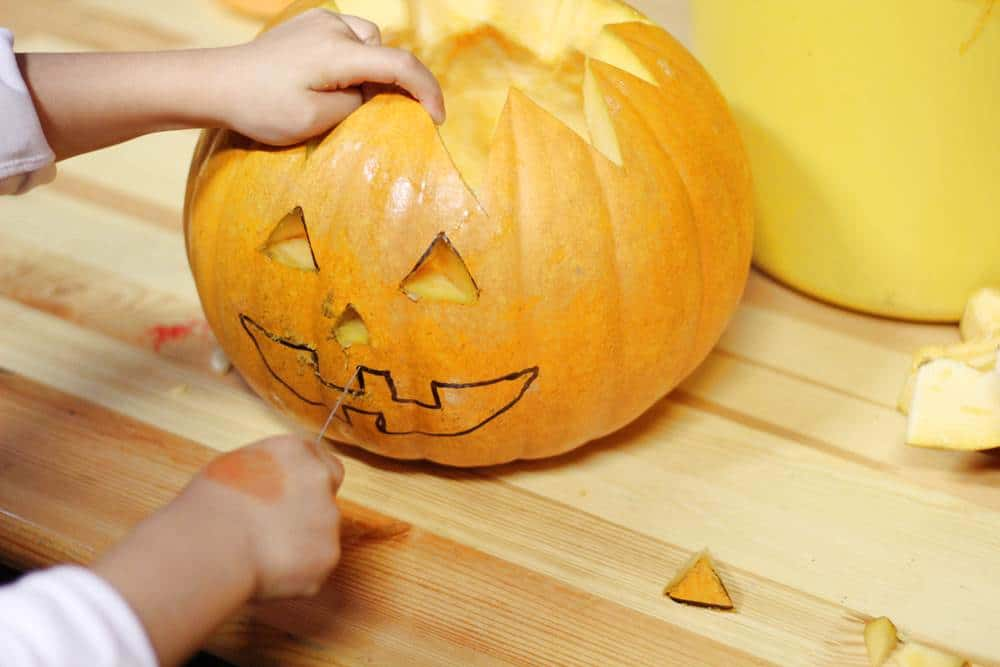Carving pumpkin mouth
