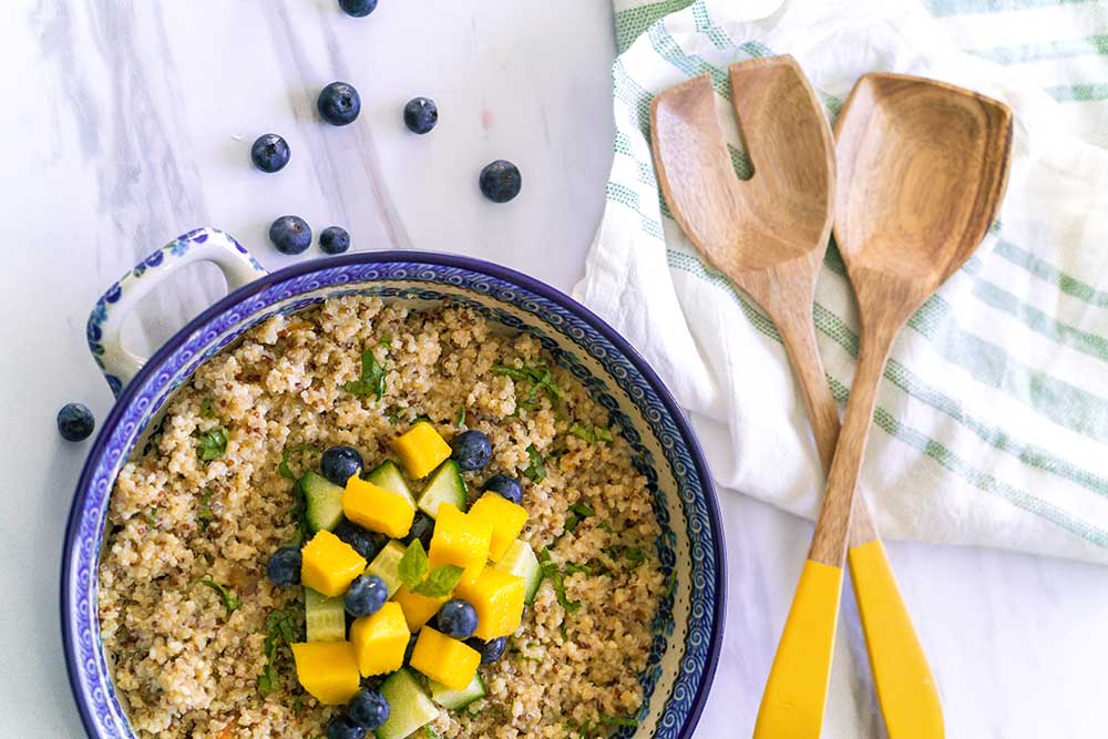 Zesty Quinoa Salad with mangos, blueberries, and cucumbers